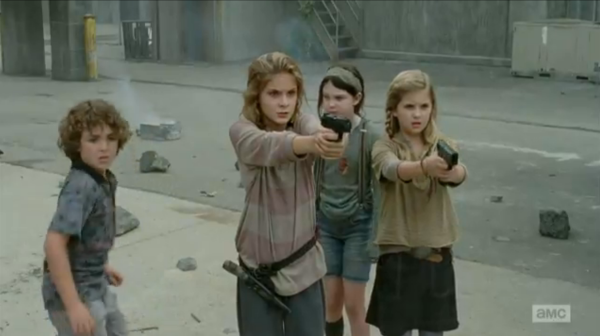 Lizzie (left) and Mika (right) save Tyresse. Carol would be so proud