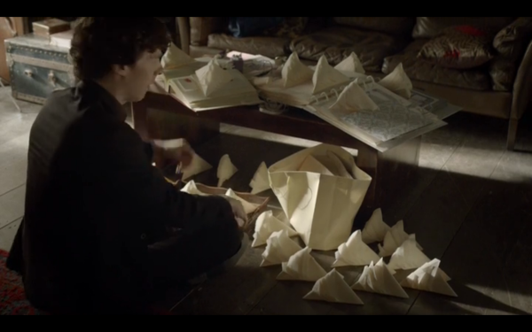 Sherlock instantaneously folds a slew of napkins into the Sydney Opera House. Nervous much?