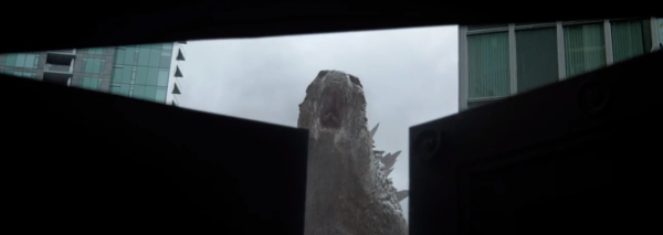 Godzilla's face is revealed in the brief seconds the door closes.