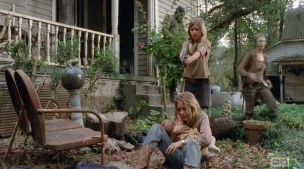 Lizzie reaches out towards the now dead dead walker