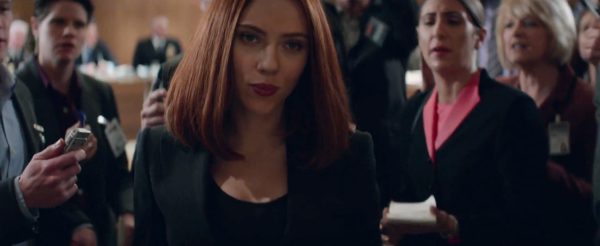 Black Widow walks out of a security hearing besieged by reporters