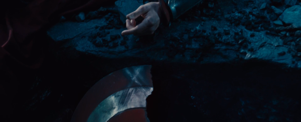 We can see Thor's arm up top and Capt's Shield shattered below